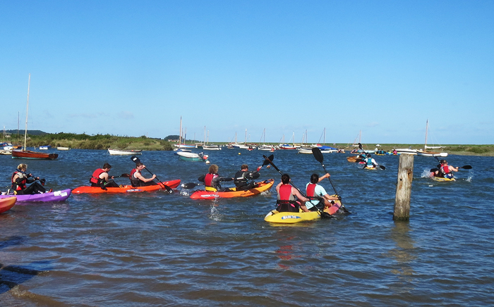 Kayaks starting off from the Staithe on a 4 mile loop around the marshes