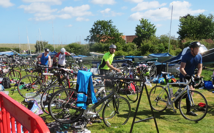 Transition from kayaks to a 45 mile bike race around the lanes and villages