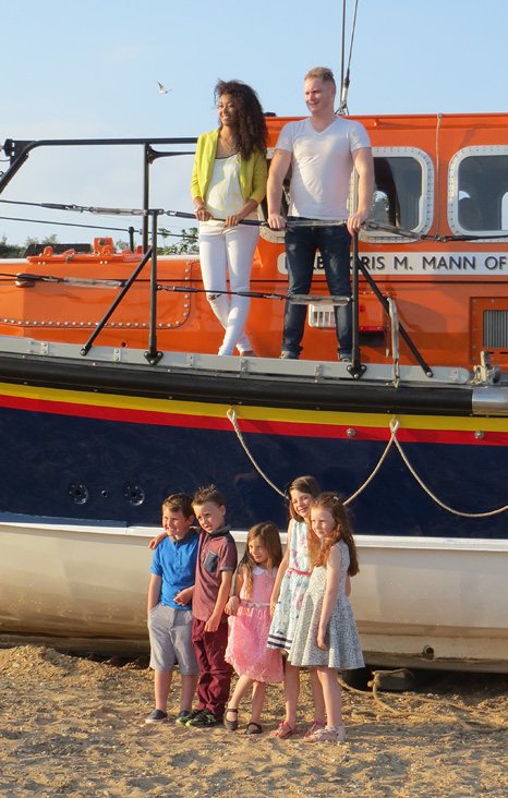 The Royal party posing with the lifeboat