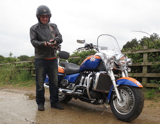 Getting ready, with his custom painted Triumph Rocket III touring
