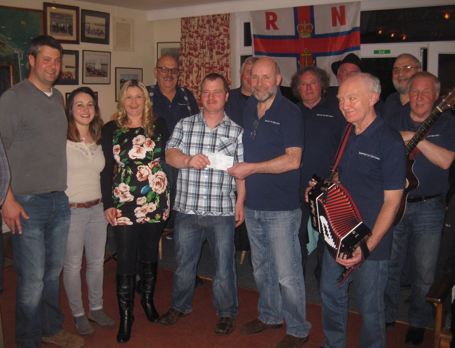 Blakeney Old Wild Rovers present cheque to Wells RNLI