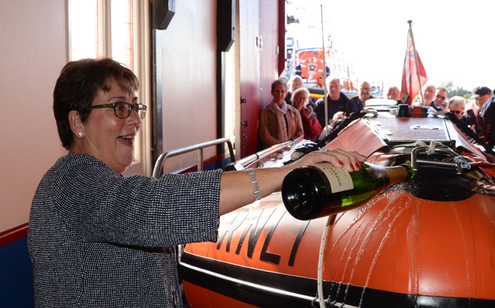 Jayne Wilcox names the station's new inshore lifeboat D-797 'Peter Wilcox'