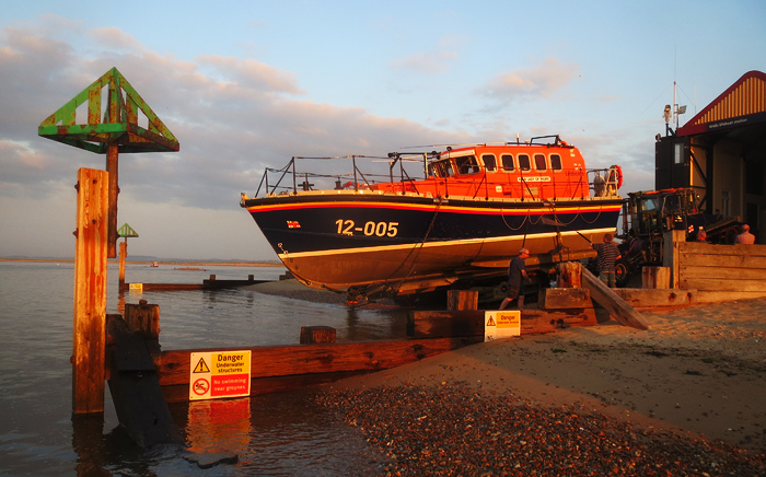 Relief lifeboat 12-005 Lady of Hilbre being washed down and recovered at Wells, 2/7/15