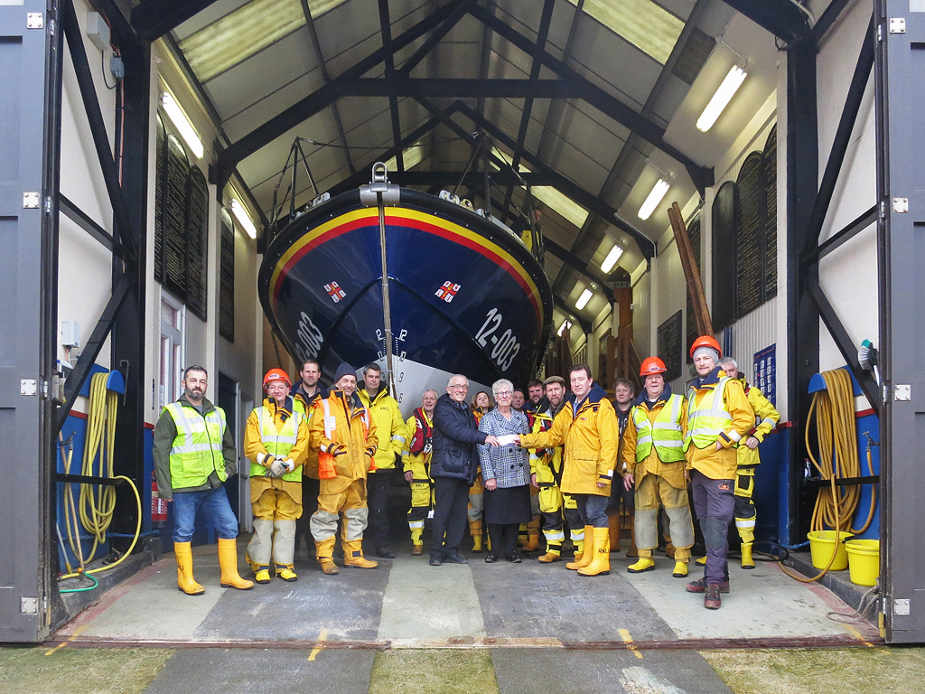 George Gray from Gressenhall Social Club presents a cheque to lifeboat operations Manager Chris Hardy before the practice launch