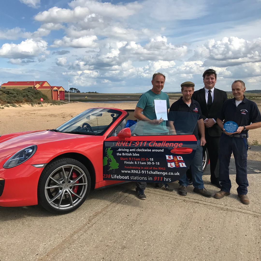 Wells Crew members with the 911 Challenge Porsche on its brief stopover in Wells en-route to all 238 RNLI lifeboat stations