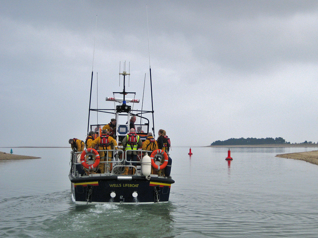 Allen at the helm with a boat-full of crew on his last exercise before retirement