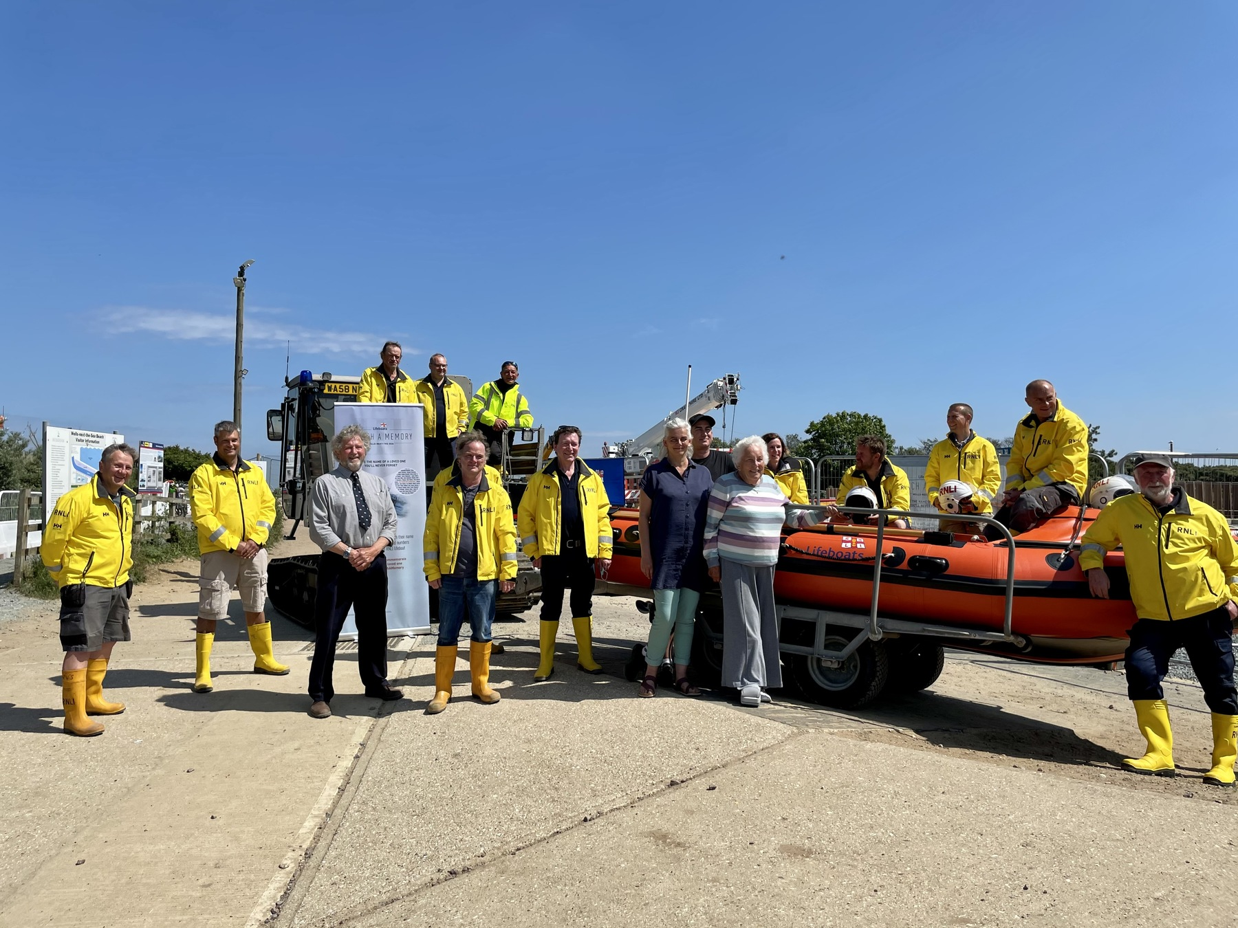 Fiona, Rob and Dorothy MacCallum with members of Wells lifeboat crew and the inshore lifeboat