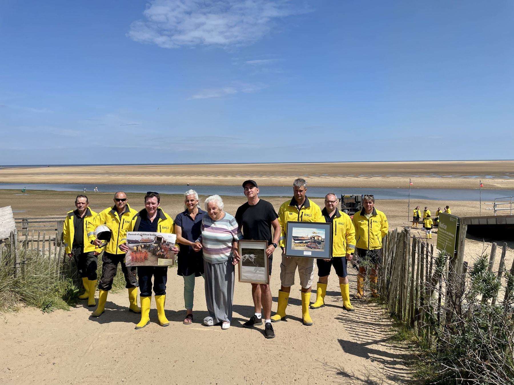 Fiona, Dorothy and Rob MacCallum with the crew and some of Campbell's photographs from the boathouse