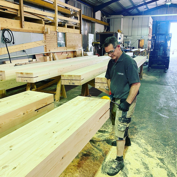 Glulam beams being prepared at Buckland Timber in Devon