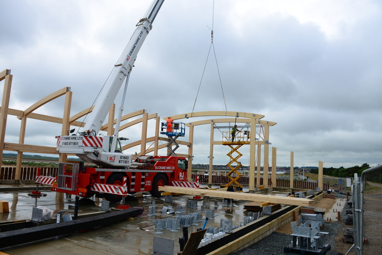 Craning the main boat hall roof beams into place
