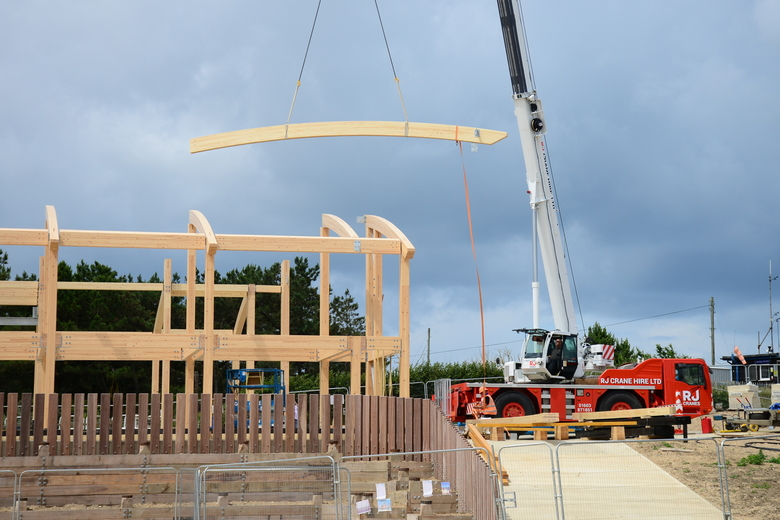 Remaining boat hall roof beams being lifted into place