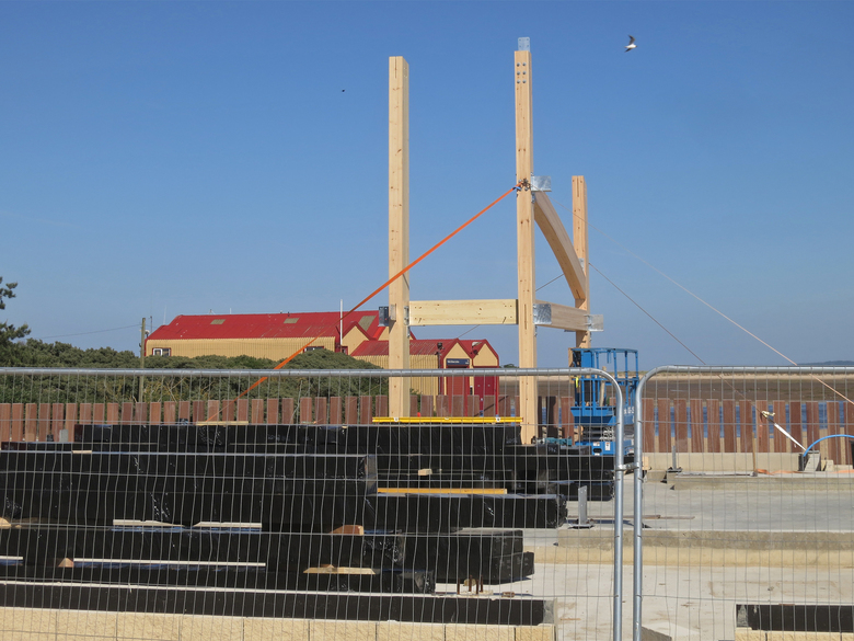 Start of the frame for the new boathouse... with the old boathouse behind