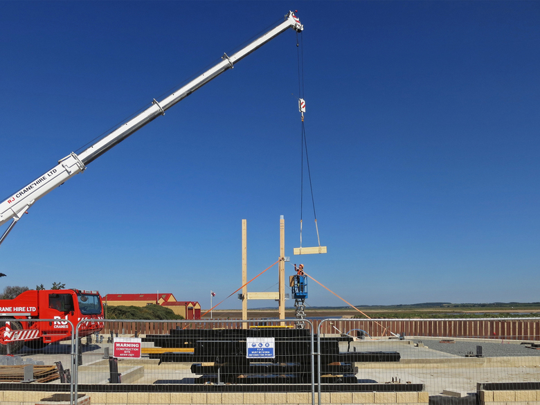 Beams being lifted and bolted into place