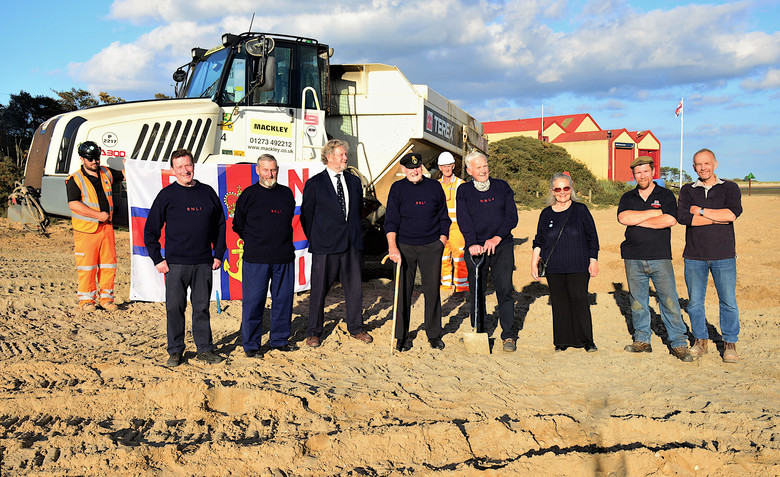 Crew members and station officials, past and present, on the beach at the start of building work, 8/9/20