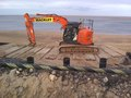 Top row of piles for the ALB ramp in position at the top of the bank