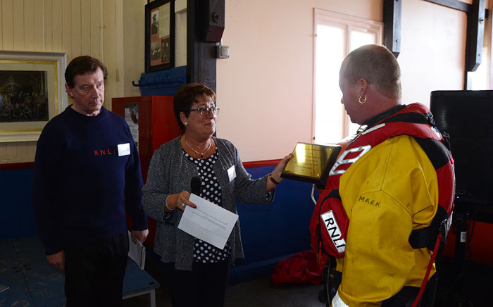 Jayne Wilcox presents Senior Helmsman Mark Frary with a dedication plaque
