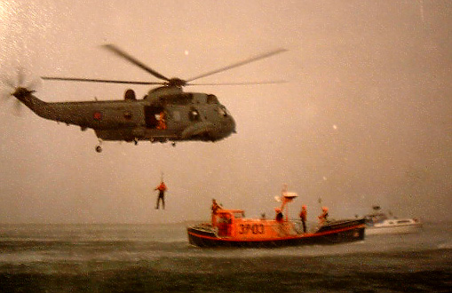 RAF Sea King in NATO green, working with the <i>Ernest Tom Nethercoat</i>
