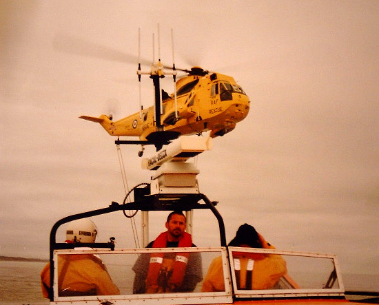 Air Sea Rescue Sea King with Wells Lifeboat. Second Coxswain Bob Smith at the helm.