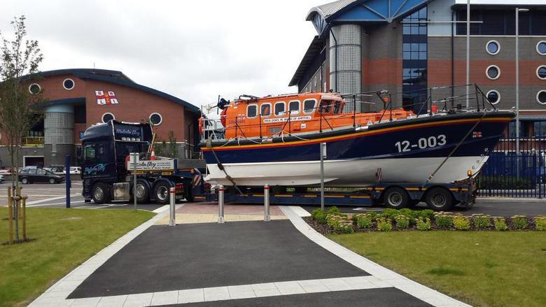 Wells Lifeboat leaves Poole All-Weather Lifeboat Centre after refit for journey home (14/9/15)