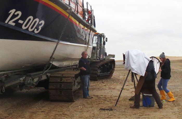 Jack Lowe setting up for a portrait of the coxswain