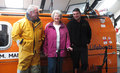 Sky divers Jill and Kieron Scillitoe with Coxswain Allen Frary at the boathouse