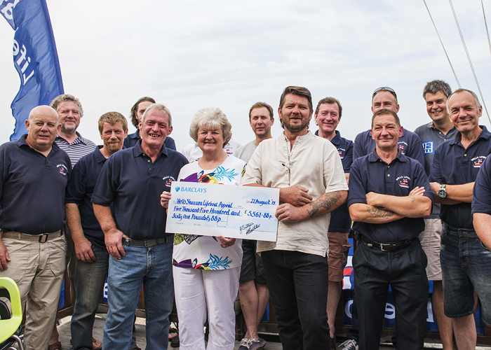 Wells crew with Jill and Kieron Scillitoe receiving a cheque for over £5500