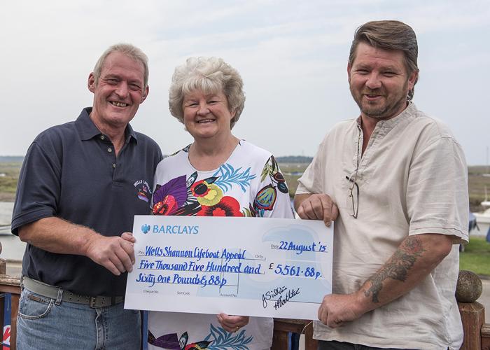 Coxswain Allen Frary (l) with Jill and Kieron Scillitoe presenting cheque for sky dive