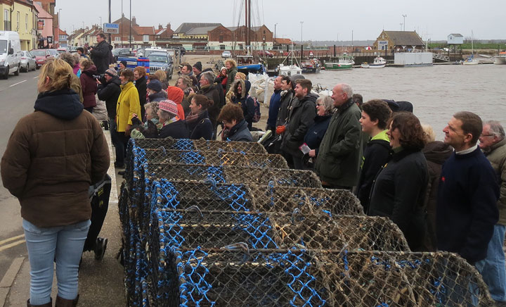 An expectant small crowd gathers on the quay for the mural unveiling 21/3/15