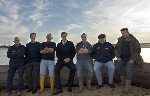 Prime Minister David Cameron with some of the crew following the December surge tide