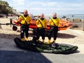 ILB crew with recovered kayak, 4 July 2014