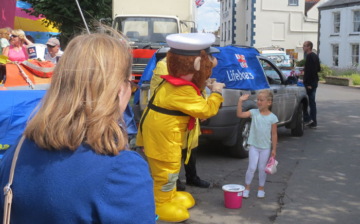 A high-five for Stormy Stan before the carnival parade