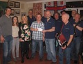 Blakeney Old Wild Rovers present cheque to Wells Deputy Second Coxswain Mark Frary