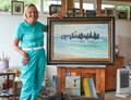 Artist Shirley Carnt with her painting 'Stallions Landing - Wells lifeboat'