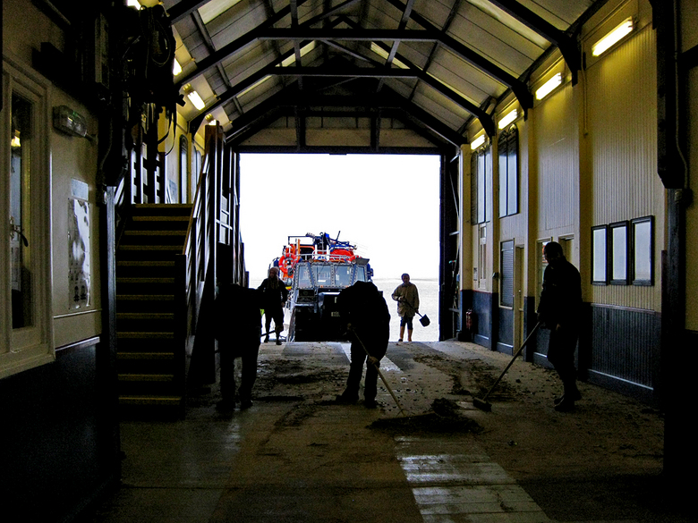 Cleaning up the boat hall after the surge tide 13/1/17