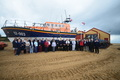 Crew members and guests with the station�s current all-weather lifeboat Doris M Mann of Ampthill