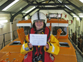 Merrick Gill visiting Wells Lifeboat station to donate �117 she raised selling cupcakes