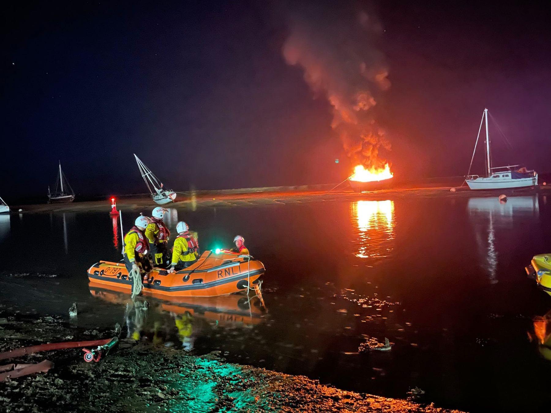 Wells inshore lifeboat attending yacht on fire near Wells quay, 15/10/21