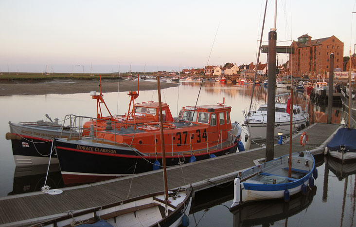Both historic lifeboats grace Wells quayside at sunset, 2 July 2012
