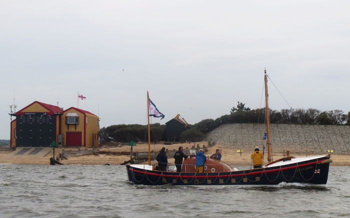 Lucy Lavers passes Wells boathouse on 4 May 15 where she served as relief boat in 1962 and 1963 64