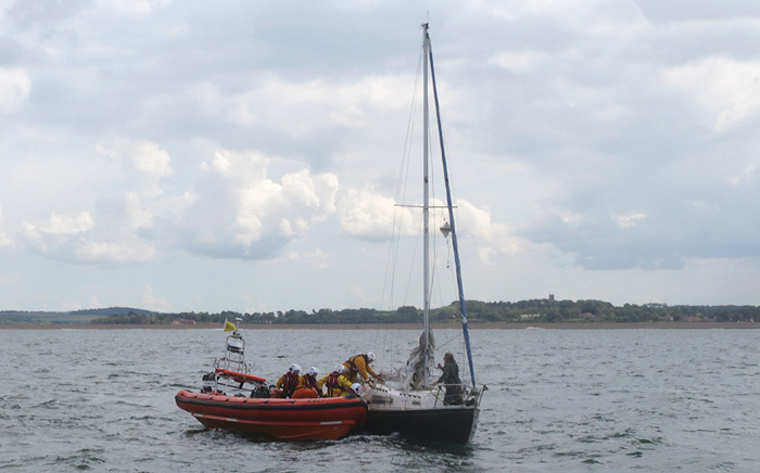 Sheringham lifeboat puts a Wells crew member onto the yacht Amanda at Blakney, 15 June 2016