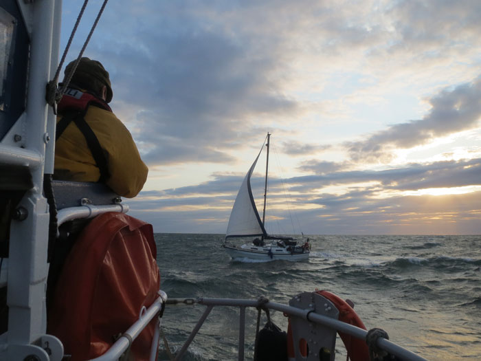 The lifeboat arrives alongside yacht Amigo, 16 August 2014