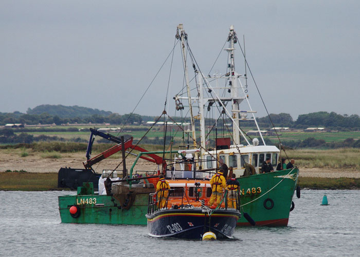 Phalarope enters Wells outer harbour under tow of the Wells Lifeboat, 9 September 2015