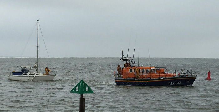 Jenny safely back in Wells harbour under tow of the Wells Lifeboat, 5 June 2016
