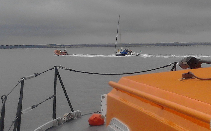 Sheringham Lifeboat towing disbaled yacht into Blakeney, 13 July 2014